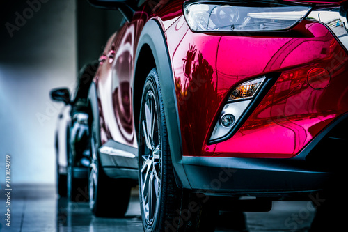 Fotografija New luxury SUV compact car parked in modern showroom for sale