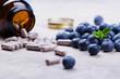 Leinwandbild Motiv Biologically active supplement - pills for healthy eyes