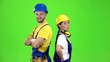 Builders of the guy with the girl touting the product and show their thumbs up. Green screen. Slow motion