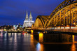 Cologne Cathedral and Hohenzollern Bridge at Twilight Time in Cologne, Germany