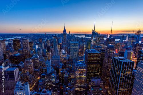 Fotografie, Obraz  New York City skyline at night - skyscrapers of midtown Manhattan with Empire St