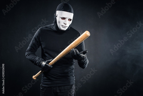 Criminal in mask and balaclava holding baseball bat Wallpaper Mural