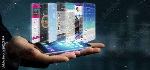 Obraz Businessman holding 3d rendering app template on a smartphone - fototapety do salonu