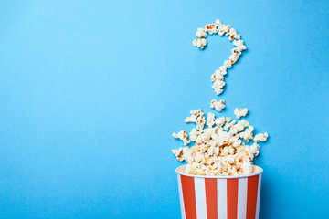 Concept of which film to choose. Spilled popcorn in the form of question mark...