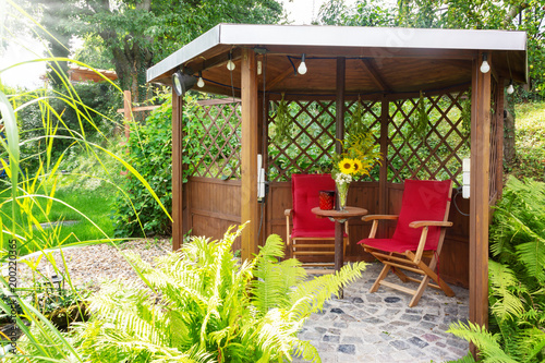 Garden Pavilion at the garden pond with sitting area and trellis Canvas Print