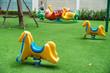 Rocking horse on children playground in the city