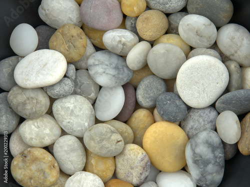 Spread and mixed beach pebbles in soft light #200229313