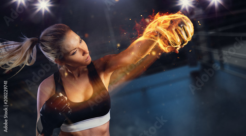 Printed kitchen splashbacks Martial arts Young blond woman with fire fist