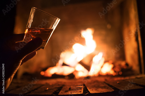 Whiskey glass with bonfire background crop