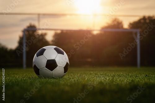 Soccer ball in the sunset Wallpaper Mural
