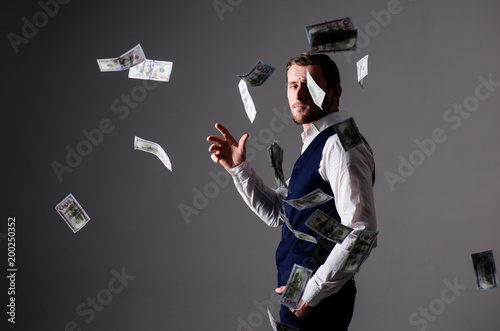 Fototapeta  Man in formal wear, businessman throwing money on grey background
