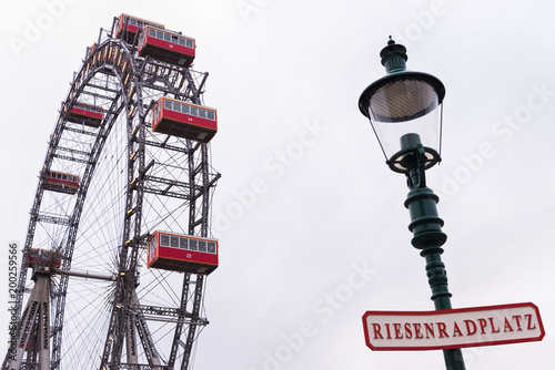 Poster Amusementspark Ferries wheel and street lamp with signboard, Prater, Vienna, Austria, overcast day