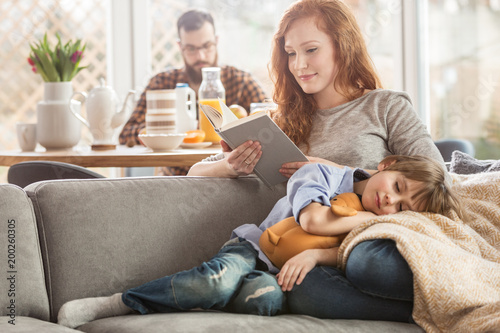 Fotografie, Obraz  Son lying on mother's laps