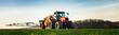 Leinwandbild Motiv Landwirt spritzt gegen Unkraut, Banner