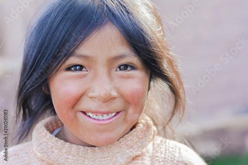 Canvastavla  Pretty little latin girl smiling happily outside.