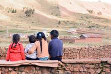 Four Latin Kids Sitting On The...