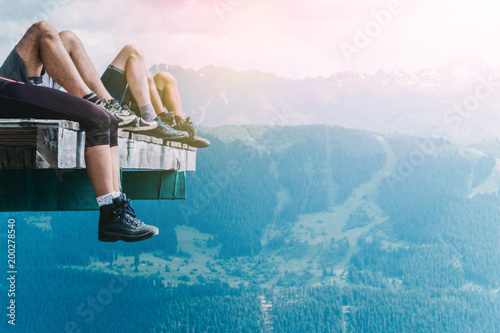 Foto  Relaxation of hikers in the mountains after a long walk, tourists legs in trekki