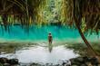 canvas print picture - Eine junge Frau in Blue lagoon auf Jamaika
