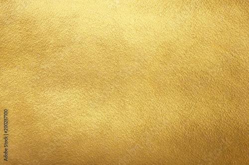 Fototapeta Gold background. Rough golden texture. Luxurious gold paper template for text design, lettering. obraz