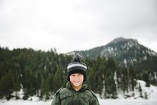 Portrait Of Smiling Boy In Winter Landscape