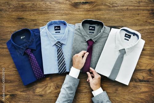Businessman arranging his formal wear Canvas