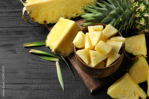 Composition with fresh sliced pineapple on table