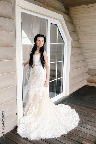 portrait of a beautiful bride with long black hair in a white dress