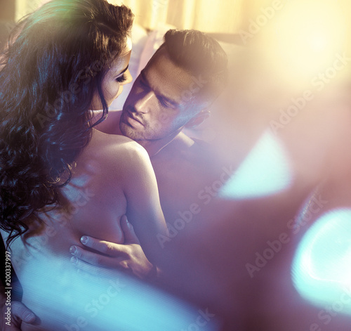 Tuinposter Artist KB Sensual couple in a luxurious bedroom