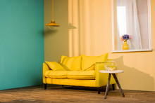 Yellow Sofa And Aquarium On Ta...
