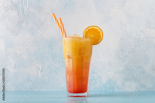 Fotografiet  Juicy Orange and Red Tequila Sunrise with ice