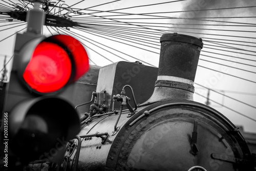 Photo  old train with red traffic light - black and white image