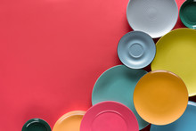 Composition Of Colorful Plates On Red Background
