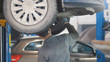Mechanic working on a tire service on the lift in a service station