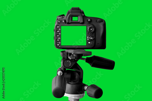 The Dslr camera with green screen on the tripod isolated on green background. The chromakey. Green screen. - 200374911
