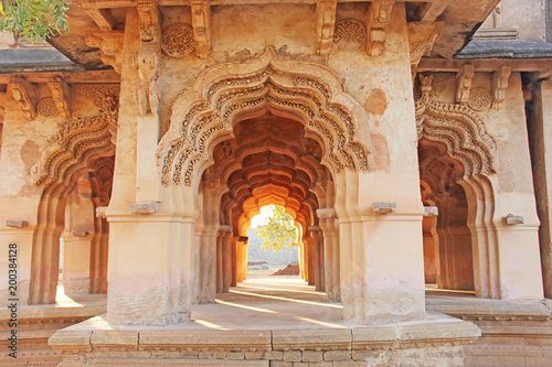 Aluminium Prints Place of worship Lotus Mahal Temple in Hampi, Karnataka, India. Beautiful carved stone arch and sunset. A popular tourist route from the GOA state. Beautiful hindu temple