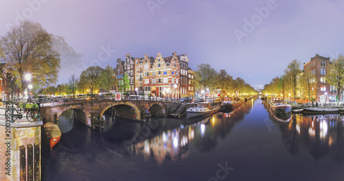 Canals of Amsterdam. Moody night panorama of Rossebuurt district Canvas Print