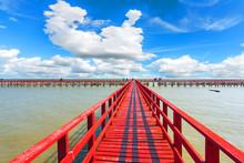 The Red Bridge And Cloudy Blue Sky Background. Bridge Cross The Sea. Samutsakhon Province Thailand.