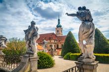 Summer View On Statues And St. Nicholas Church Of Vrtba Garden (18th Century), Prague