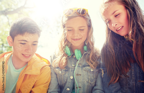 technology, internet and people concept - three happy teenage