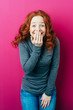 canvas print picture - Young red-haired laughing woman on pink background