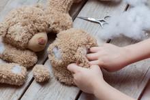 A Girl Sews A Bear Toy. Handic...