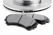 Brake pads and brake discs on white background. Auto parts