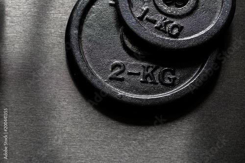 Poster Fitness deux disques de poids différents