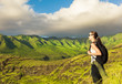 Female hiking in the mountains of Hawaii. Adventure and active lifestyle concept.