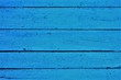 structure of vertical wooden boards with a blue background