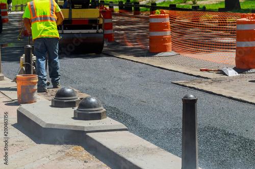 Foto op Canvas Begraafplaats Worker operating asphalt paver machine during road construction repairing works