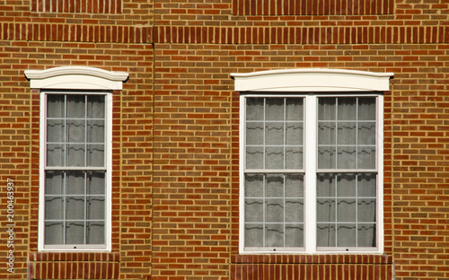 Photo Two adjacent windows with bricks background