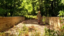 Young Boy On An Abandoned Bridge