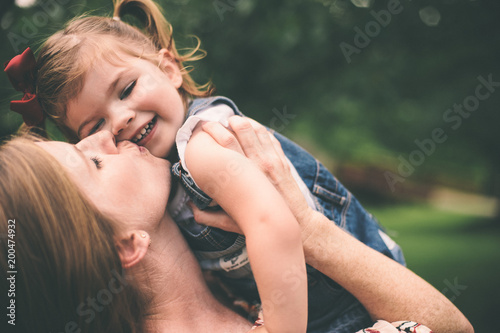 Fotografie, Obraz  Mother holding daughter and showing affection