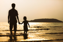 Silhouette Of Asian Father And...
